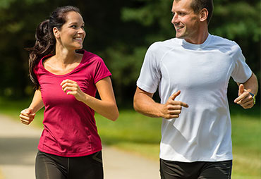 Couple enjoying a run after receiving chiropractic care