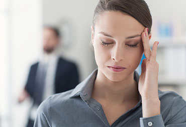 Woman suffering from migraines needing chiropractic care