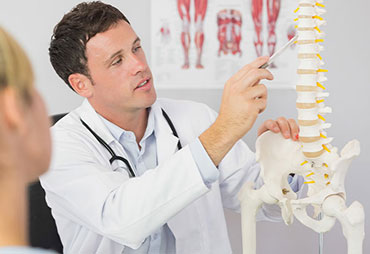 Chiropractor explaining chiropractics to patient