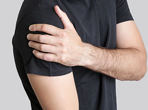 Man suffering with frozen shoulder